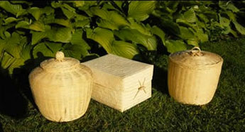 Bamboo Urns sitting on grass under a bush